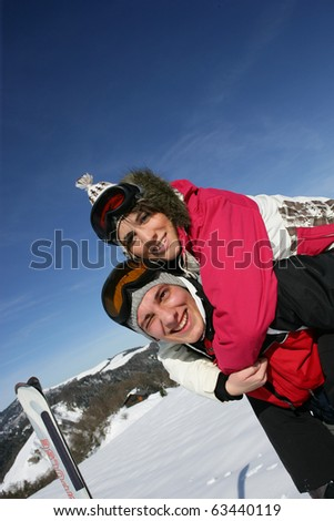 Young couple in snow - stock photo