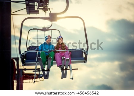 Young couple in sportswear on a lift