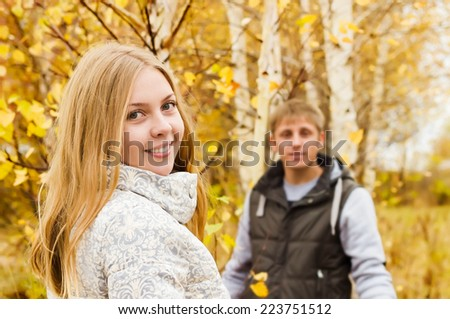 Young couple in the autumn park - stock photo