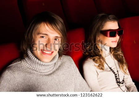 young couple in the cinema to enjoy the movie - stock photo