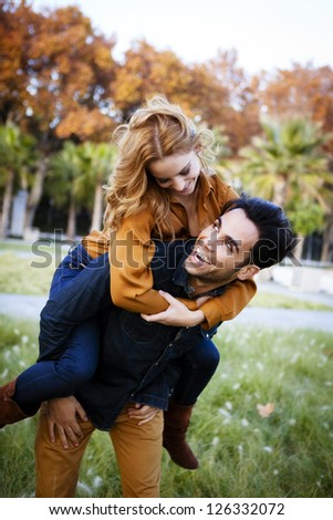 Young couple in the countryside in autumn. - stock photo