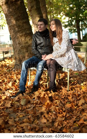 Young couple in the Luxembourg garden of Paris at fall - stock photo