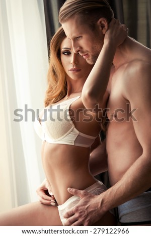 Young couple in the room  - stock photo
