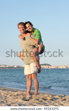 Young couple in the sunset light on the beach