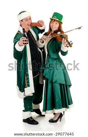 Young couple in traditional St Patrick holiday outfit. Studio shot. - stock photo