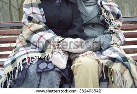 Young couple in winter.I love spending free time with you.couple in love wrapped in a blanket in the winter forest