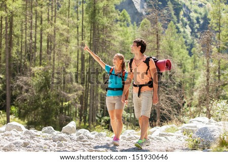 Young couple is doing trekking in the mountains - stock photo