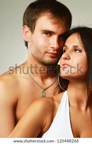 Young couple isolated on grey  background - stock photo