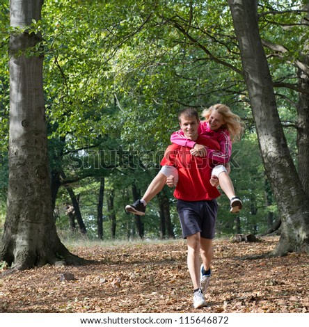 Young couple jogging in park - stock photo