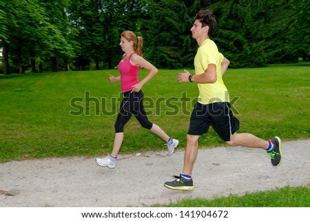 Young couple jogging in the park