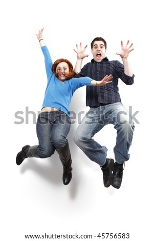Young couple jumping in the air.