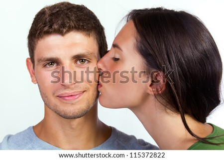 young couple kissing - stock photo