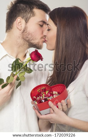Young couple kissing and celebrating Valentine�s Day  - stock photo