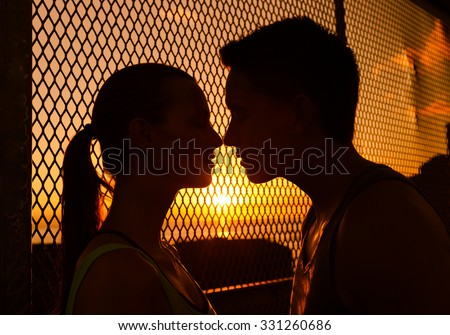 Young couple kissing in a beautiful setting.  - stock photo