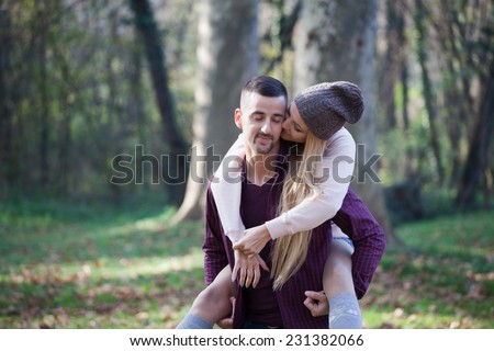 Young couple kissing in autumn park - stock photo