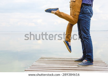 Young couple kissing in soft light - stock photo