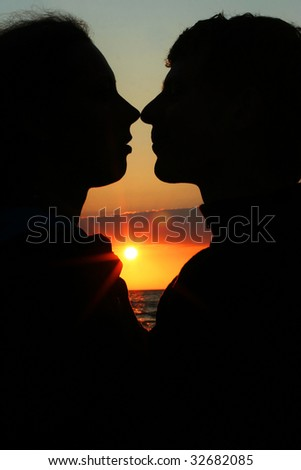 young couple kissing on the coast - stock photo