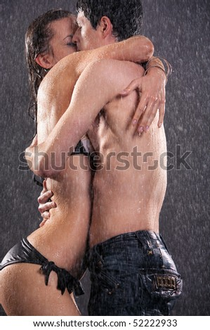 Young couple kissing. Water studio photo. - stock photo