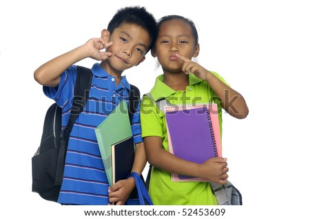 Young couple little kids ready for school - stock photo