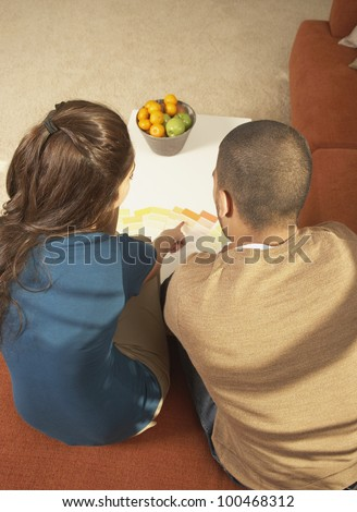 Young couple looking at color swatches