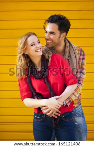 Young couple looking at each other showing love. - stock photo