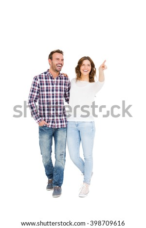 Young couple looking away and smiling on white background - stock photo