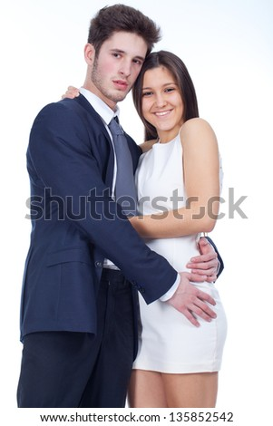 young couple� looking happy, with white background behind - stock photo