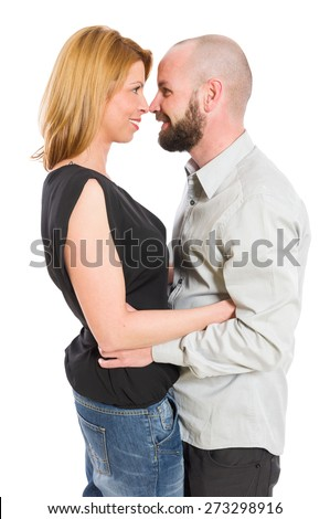Young couple looking into each other's eyes. Romantic couple inlove on white background - stock photo