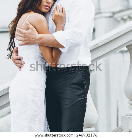 Young couple loving each other. Man hugging a woman. - stock photo