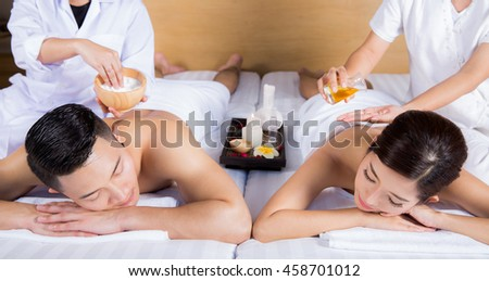 Young couple lying on the massage table and smiling, spa concept - stock photo