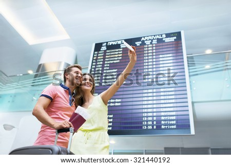 Young couple making selfie at the board - stock photo