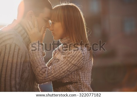 Young couple man and woman gently and passionately embracing  - stock photo