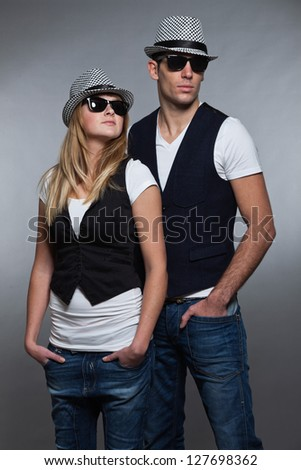 Young couple man and woman in love. Sunglasses and hat.