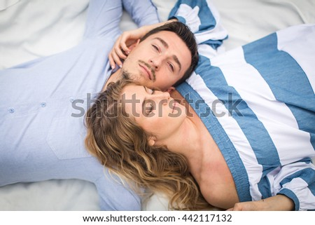 young couple man and woman lie on the rug on nature, the concept of  love story