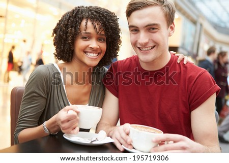 Young Couple Meeting On Date In Cafe - stock photo