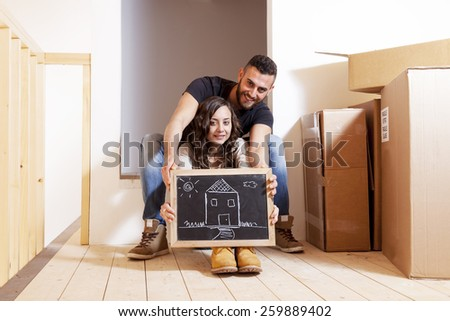 Young couple carrying boxes new house stock photo 265247801 shutterstock - Young couple modern homes ...