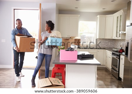 Young Couple Moving In To New Home Together - stock photo