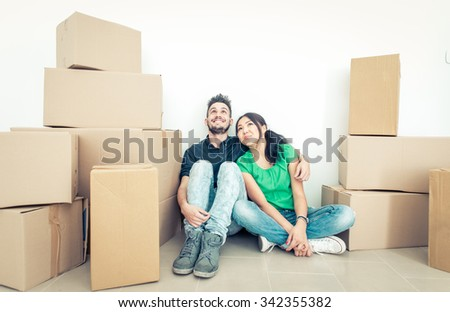 Young couple moving into new apartment. concept about real estate business and people - stock photo