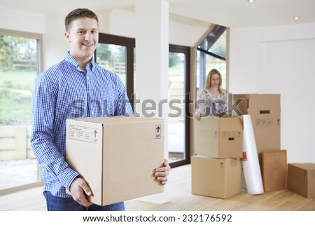 Young Couple Moving Into New Home Together - stock photo