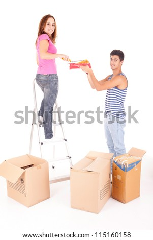Young couple moving to new house, isolated over white