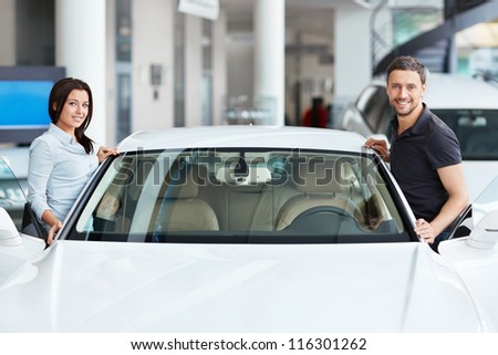 Young couple near the vehicle - stock photo