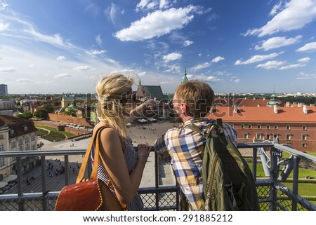 Young couple of tourists standing on the observation platform of the Castle Square in Warsaw, Poland. - stock photo