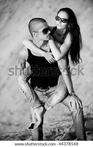 Young couple on a beach - stock photo