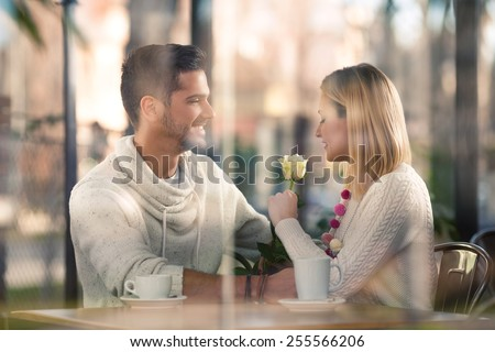 Young couple on a romantic date in a cafe - stock photo