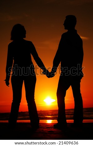 Young Couple on a sunset - stock photo