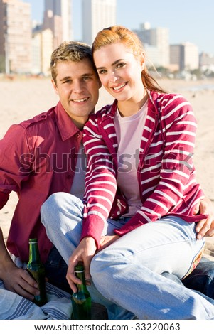 young couple on beach - stock photo