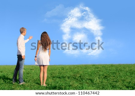 Young couple on field dreaming about their new house