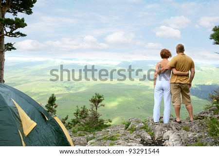 young couple on nature with tent - stock photo
