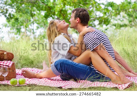 Young couple on picnic at forest - stock photo