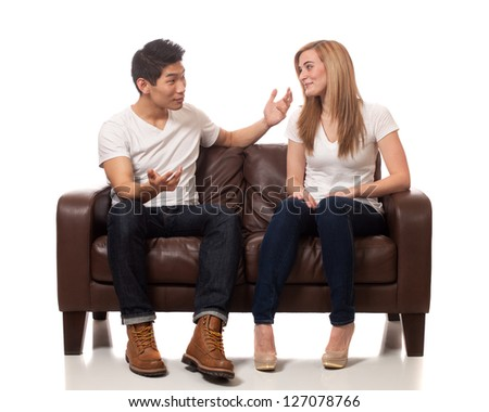 Young Couple on Sofa - stock photo